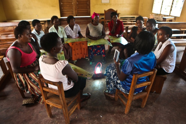 A women's group meets in Mityana, Uganda to discuss deployment of low-cost solar lights in a program spearheaded by Solar Sister. Photograph courtesy James Akena, Solar Sister